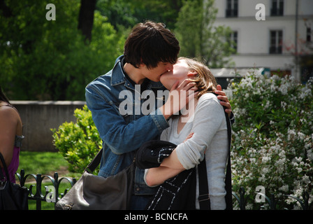young French couple kissing, Paris France - Stock Photo
