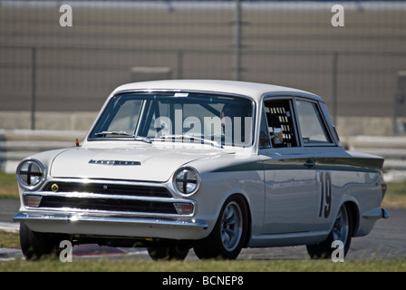 A 1966 Ford Lotus Cortina at a vintage racing event - Stock Photo