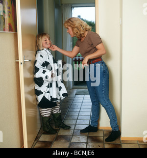 Stressed mother and child being told off - Stock Photo