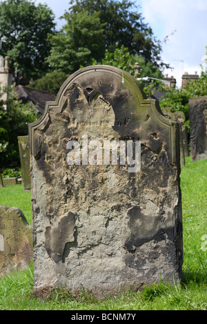 A worn headstone in an English churchyard. - Stock Photo