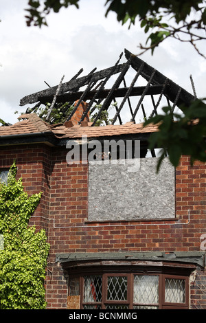 A fire damaged house. - Stock Photo