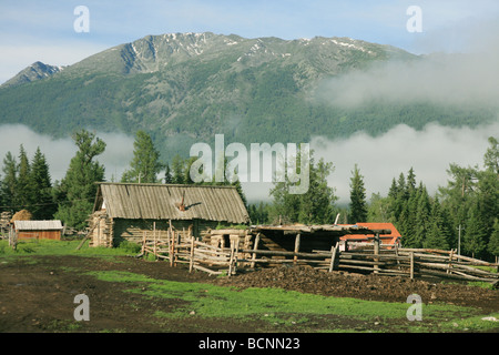 Wooden shed at the foot of hill, Kanas Conservation, Xinjiang Uyghur Autonomous Region, China - Stock Photo