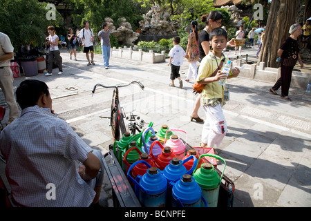 Visitors and peddler in the Imperial Garden in the Forbidden City, Beijing, China - Stock Photo
