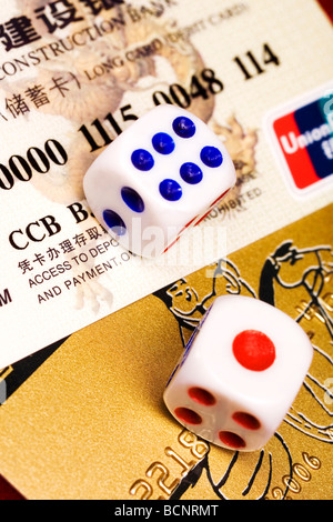 Two dices on Chinese credit cards - Stock Photo