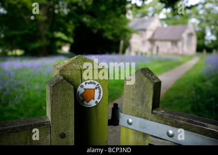 A public footpath leading through a churchyard in Warwickshire, UK - Stock Photo