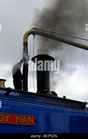 Steam train taking on water - Stock Photo