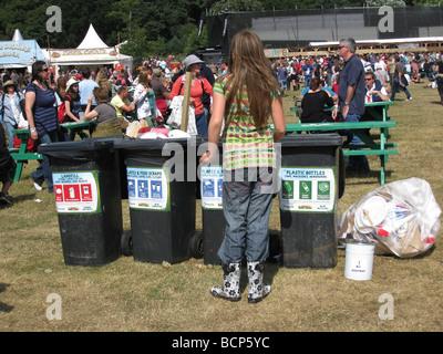 girl recycling at Latitude - Stock Photo