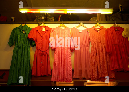 Dresses for sale on display in a vintage store - Stock Photo