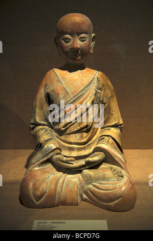 Colored clay sculpture of an Arhat from West Xia Dynasty, Capital Museum, Beijing, China - Stock Photo