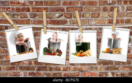 Baby Chefs in Pots Hanging on Film Blanks Against Brick Background - Stock Photo
