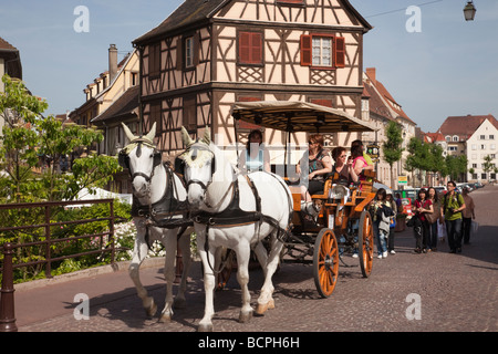 Colmar Haut-Rhin Alsace France Tourists horse and carriage sightseeing tour in 'Little Venice' area of old town - Stock Photo