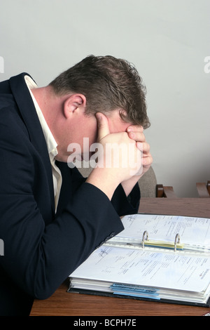 Very distressed company manager - Stock Photo
