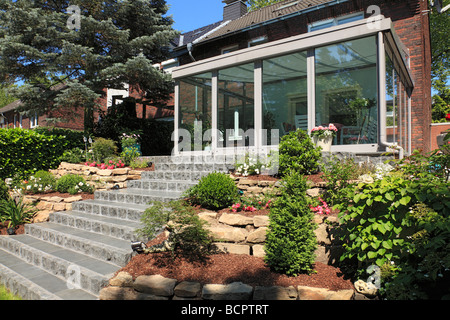 Winter Garden And Residential House Row Side Flower Rock