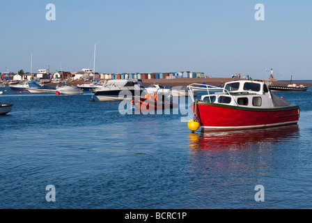 Boats on the river Teign, looking across from Shaldon towards the beach huts on Teignmouth spit. - Stock Photo