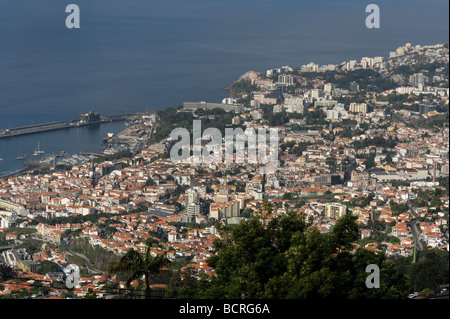 Funchal the capital city of Madeira and the port looking down from Livramento - Stock Photo