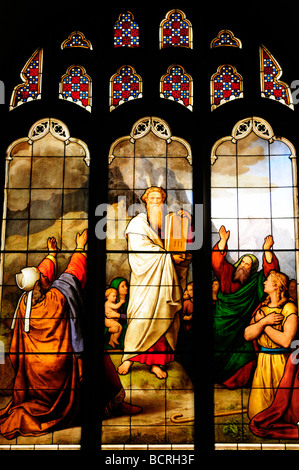 Stained Glass Window  depicting Moses and the 10 Commandments in Peterhouse College Chapel, Cambridge England UK - Stock Photo