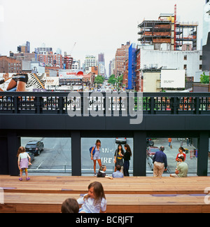 The new High Line Park wooden seating architecture with people family viewing windows over city and streets of New - Stock Photo