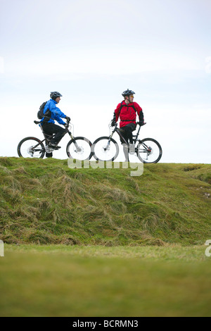 Mountain bikers on the south downs in the winter - Stock Photo