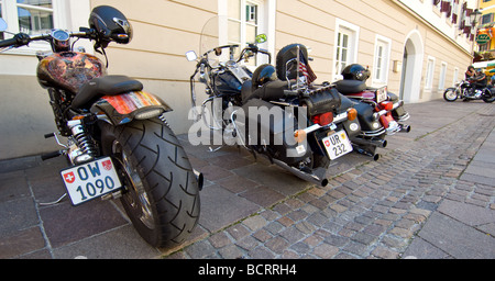 Harley Davidson motorbikes parked in the town square in Zell am See, Austria. - Stock Photo
