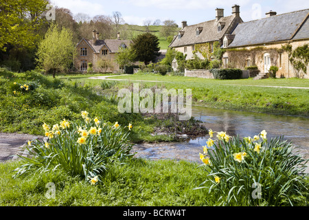 Cottages beside the ford across the River Eye in the Cotswold village of Upper Slaughter, Gloucestershire - Stock Photo