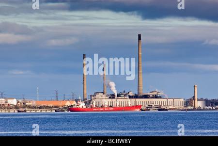 A ship docked at the Alcoa alumina refinery in Kwinana, Perth, Western Australia - Stock Photo