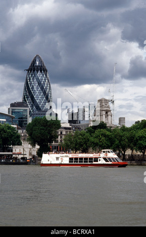 July 20, 2009 - View across the Thames of the Swiss Re Gherkin and Ten Trinity Square in the City of London. - Stock Photo