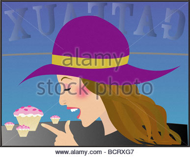 Female wearing hat in cake shop - Stock Photo