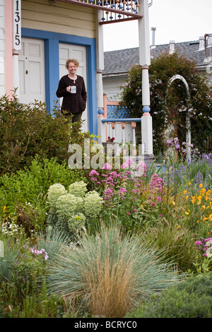 Marvelous Amy Stewart On Her Front Porch And No Lawn Flowering Perennial Garden    Stock Photo