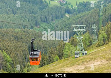 Schmittenhohe cable car taking passengers from Schmitten to Schmittenhohe ski resort in Austria - Stock Photo