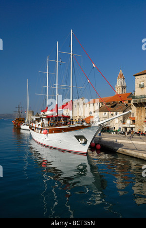 Three masted yacht on Riva seafront of Trogir on Dalmatian Coast of Croatia - Stock Photo