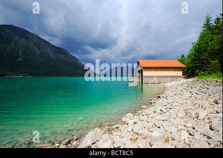 Boathouse on Walchensee lake, Mt. Jochberg on the horizon, district of Bad Toelz-Wolfratshausen, Bavaria, Germany, - Stock Photo