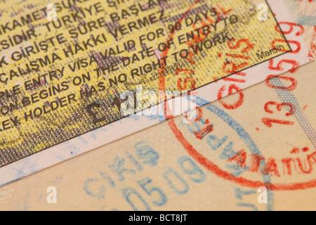 Turkey Turkish tourism tourist travel visa entry stamp in passport - Stock Photo