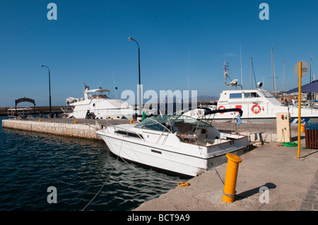 Yachts moored on the jetty at the Venetian harbour in Chania, Crete, Greece. - Stock Photo