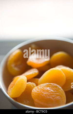 closeup of a bowl of dried apricots - Stock Photo