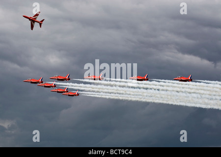 The RAF Red Arrows aerobatic team low level run and break - Stock Photo