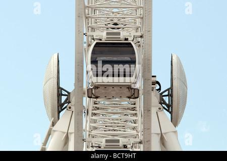 Single empty gondola aligned on the centre of newly constructed 'Ferris Wheel' - Stock Photo