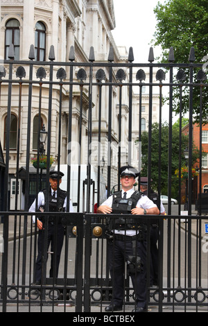 Armed Metropolitan police officers at the enterance to Downing Street, Westminster, London, England, U.K. - Stock Photo