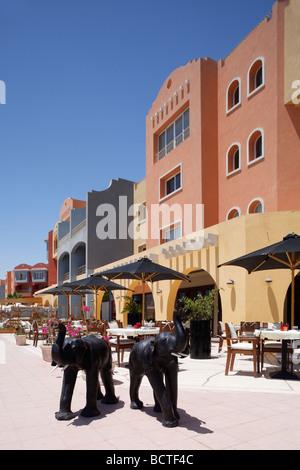 Open air restaurant, parasols, elephant sculptures, marina, Hurghada, Egypt, Red Sea, Africa - Stock Photo