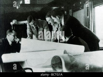 Reichsleiter Bouhler, Prof. Speer, Adolf Hitler, Dr. Brand, Reichsleiter Bormann during a meeting in the special - Stock Photo