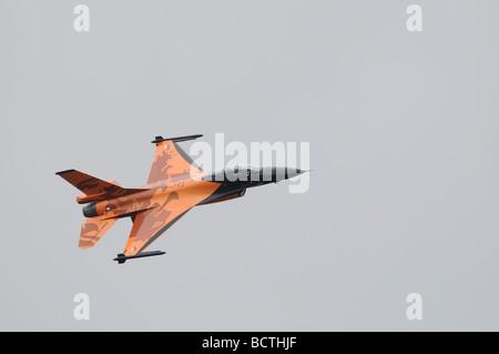 Royal Netherlands Air Force Koninklijke Luchtmacht  F-16 Fighter Jet in distinctive 'one mission' orange paint scheme. - Stock Photo