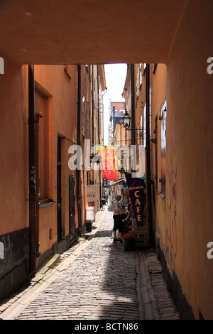 A side street in Stockholm, Sweden, containing a cafe and a shop selling silk goods. - Stock Photo