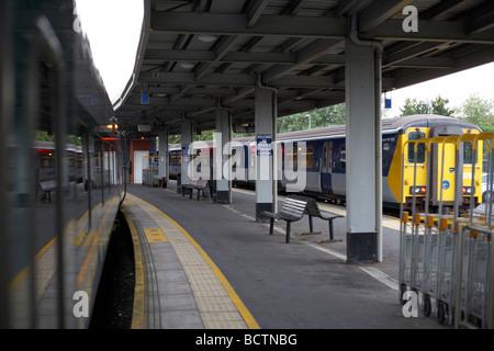 trains on empty platforms in belfast central station northern ireland - Stock Photo