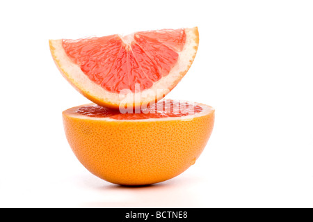 grapefruit slices arranged on top of each other. - Stock Photo