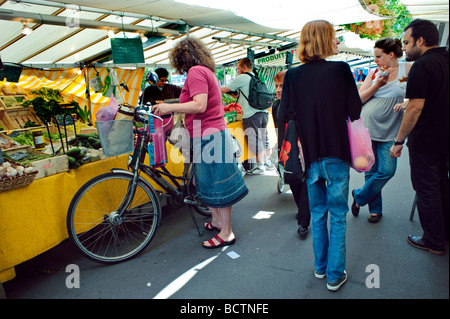 Paris France, Outside Food Market French Woman SHopping with Bicycle, Stall Display, bicycling on street - Stock Photo