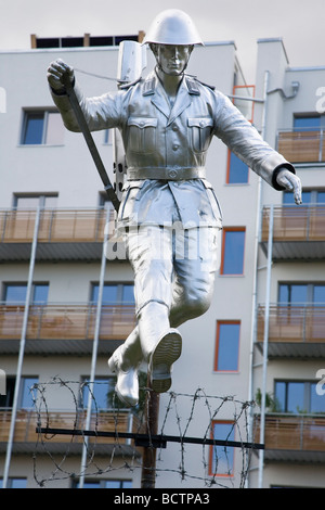 Monument to East German border guard Conrad Schumann, Bernauer Strasse, Berlin, Germany - Stock Photo