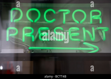 doctor present neon sign in the window of a chemists shop in dublin republic of ireland - Stock Photo