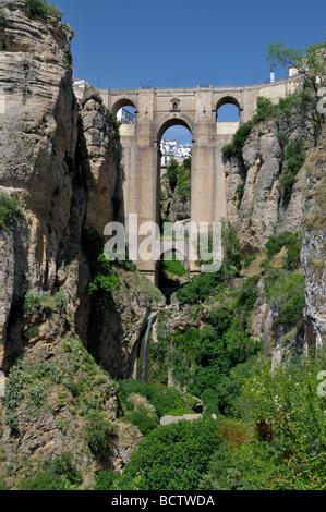 Looking up at the el Puente Nuevo or 'New Bridge' over Tajo River Ronda Andalusia Spain - Stock Photo