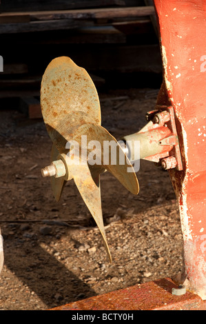 Rusty propeller in an old fishing boat in dry dock Gloucester MA - Stock Photo