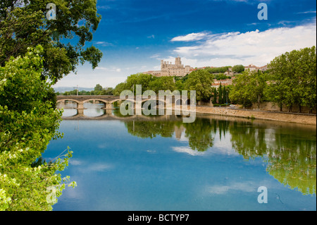 A view of the Cathedral Saint Nazaire and the River Orb in Beziers France - Stock Photo
