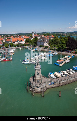 View of the port of Lindau with the monument of the lion overlooking the lake by sculptor Johann von Halbig, Lindau - Stock Photo